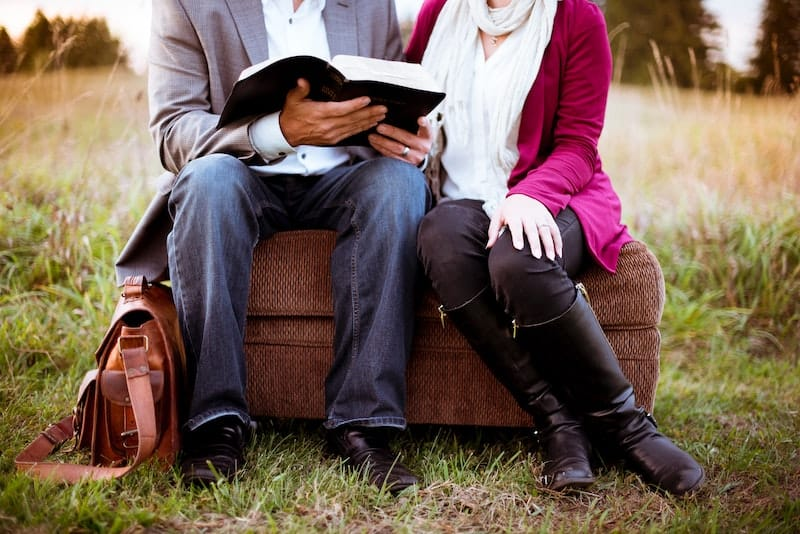 a man and woman reading bible